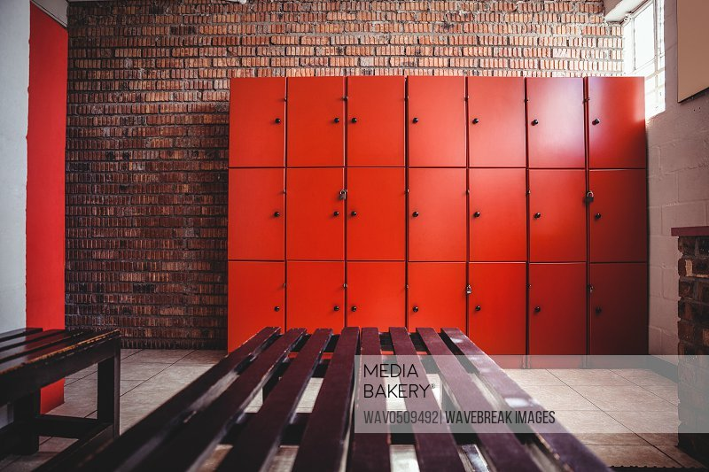 Empty locker room and a bench in fitness studio