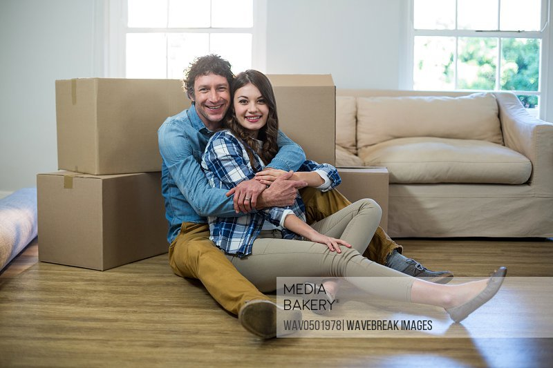 Couple sitting on the floor at home