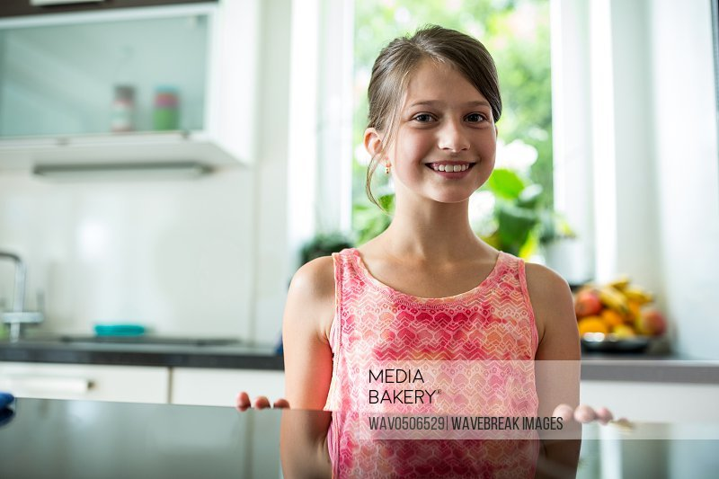 Portrait of smiling girl in the kitchen at home