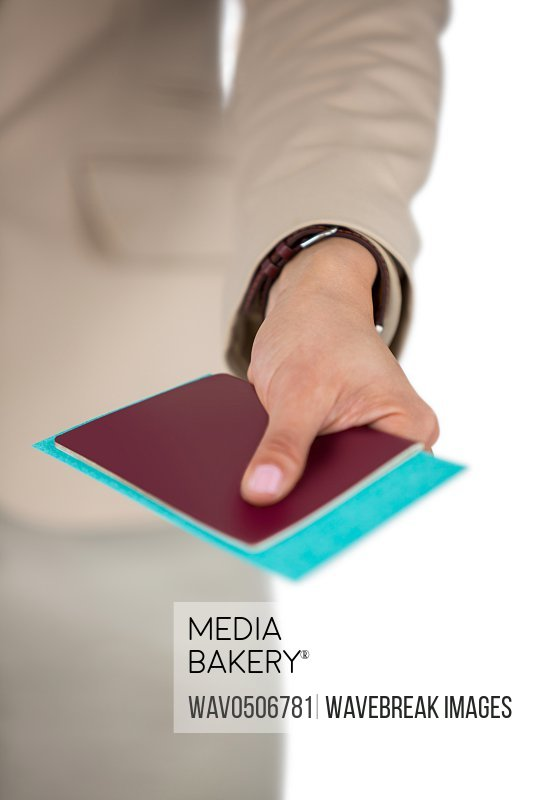 Midsection of Businesswoman holding passport