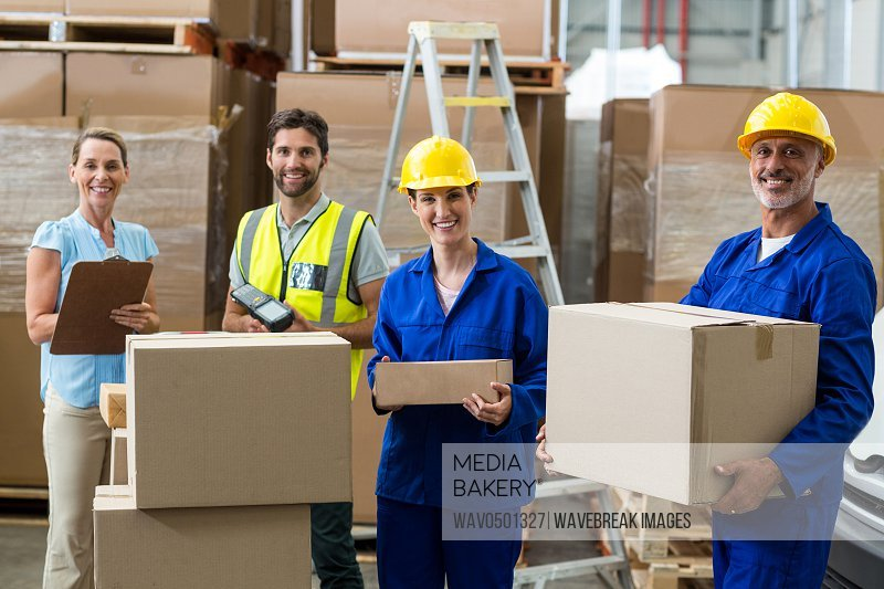 Portrait of warehouse worker standing together in warehouse