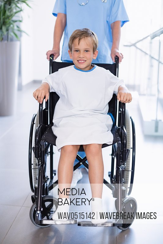 Portrait of smiling disable boy in wheelchair