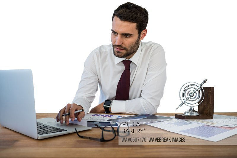 Businessman working on laptop in office against white background