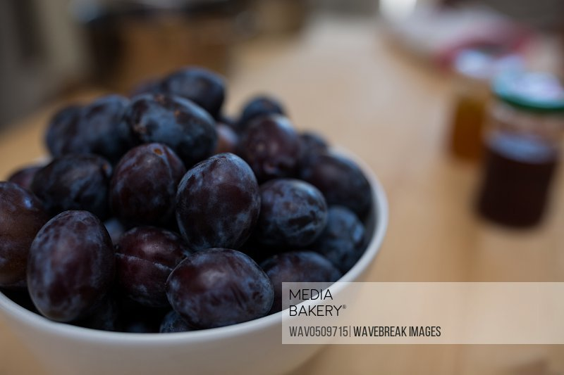 Close-up of grapes in a bowl on table in kitchen