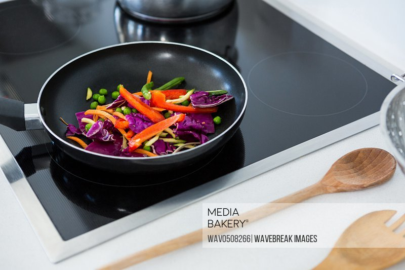 Food on a induction cooktop in kitchen at home