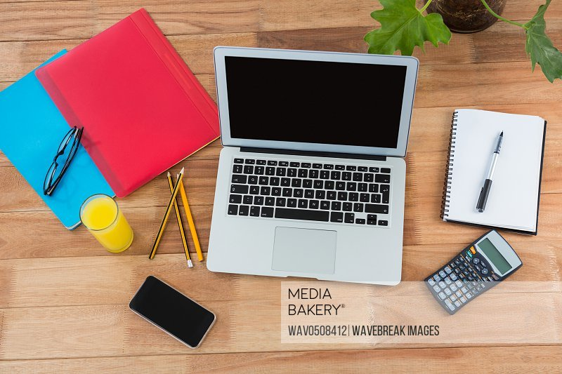 Office accessories with mobile phone and laptop on table