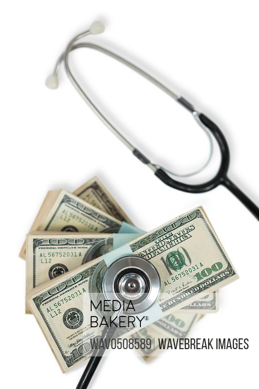 Stethoscope on bundle of currency note