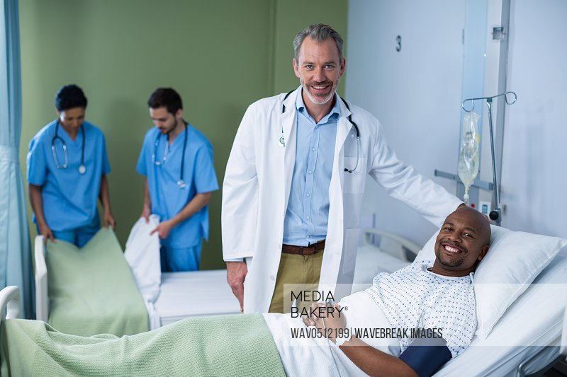 Portrait of doctor and patient during visit in ward