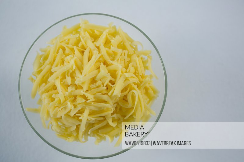 Glass bowl of grated cheese