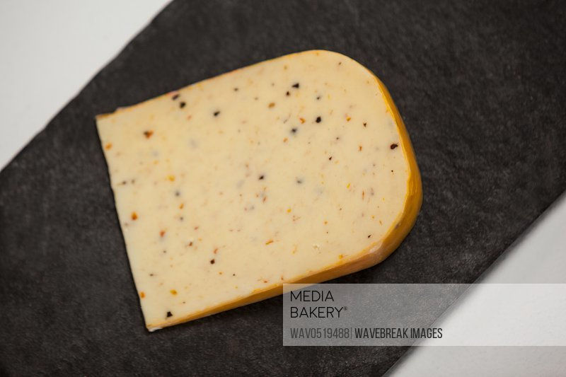 Slice of cheese on chopping board