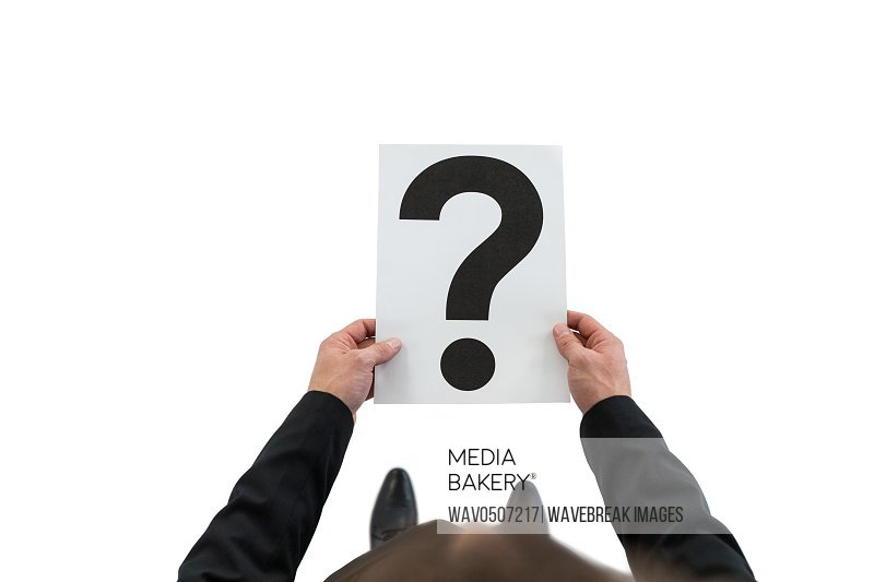 Businessman holding paper with question mark sign on white background