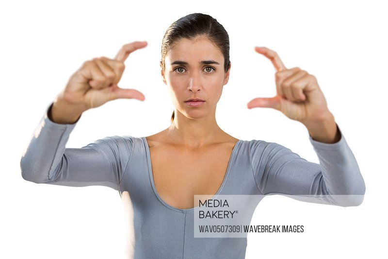Portrait of confident woman gesturing against white background