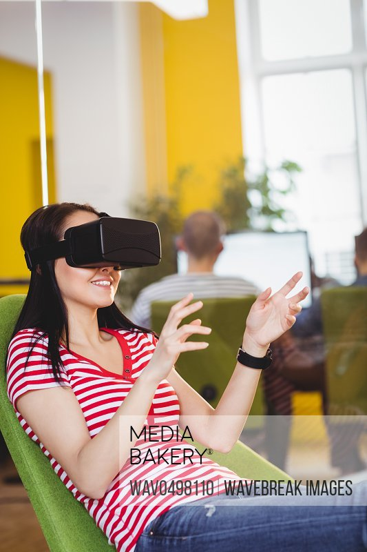 Young female executive enjoying augmented reality glases at office