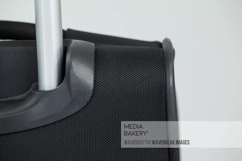 Close-up of travel bag on white background