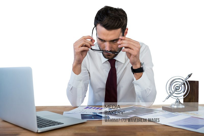 Businessman wearing spectacle while working in office against white background