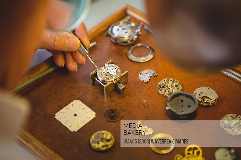 Horologist repairing a watch in the workshop