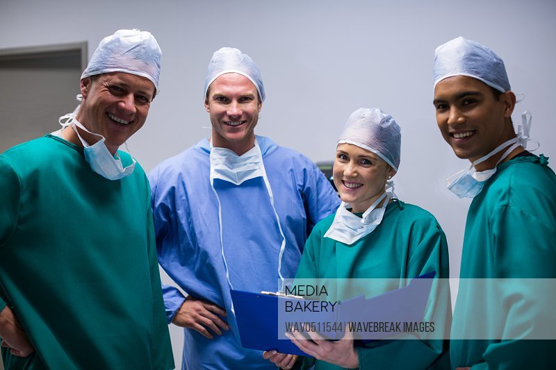 Portrait of surgeons team standing in corridor of hospital