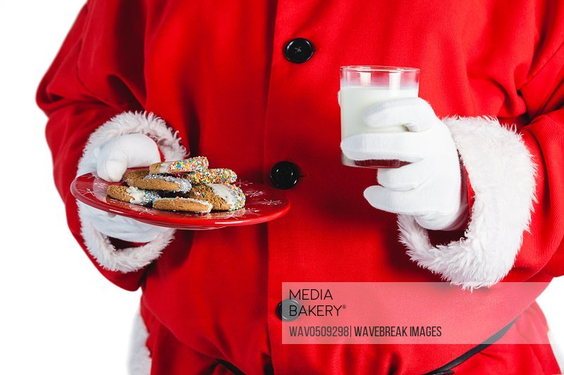 Santa claus holding a glass of milk and cookies