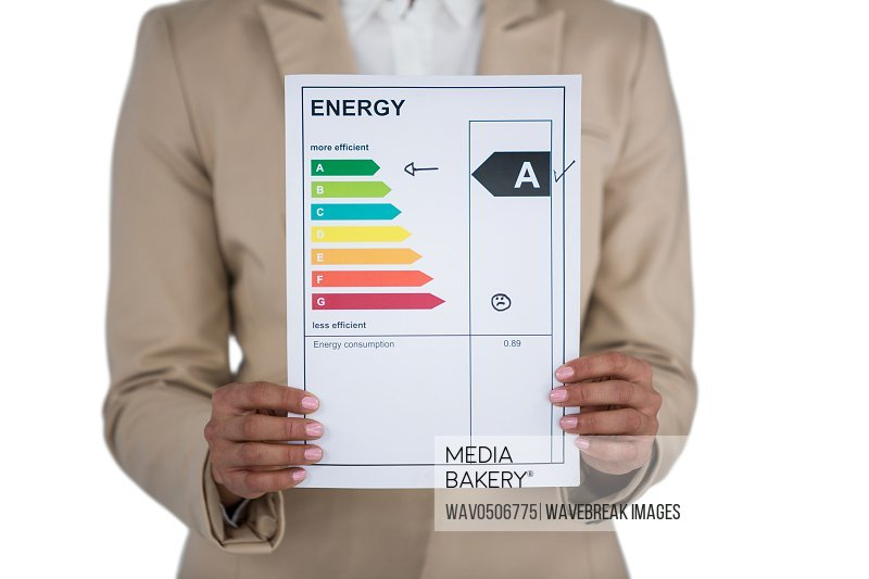 Mid-section of Businesswoman holding graph chart against white background