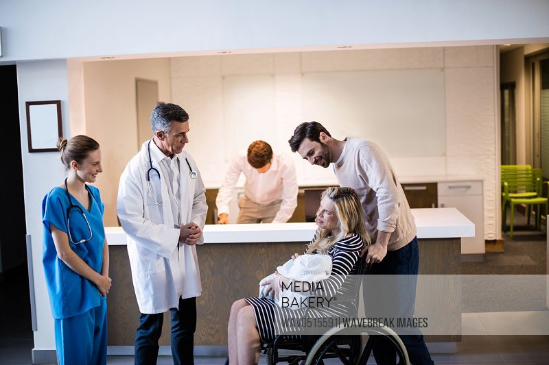 Doctors and patient interacting with each other