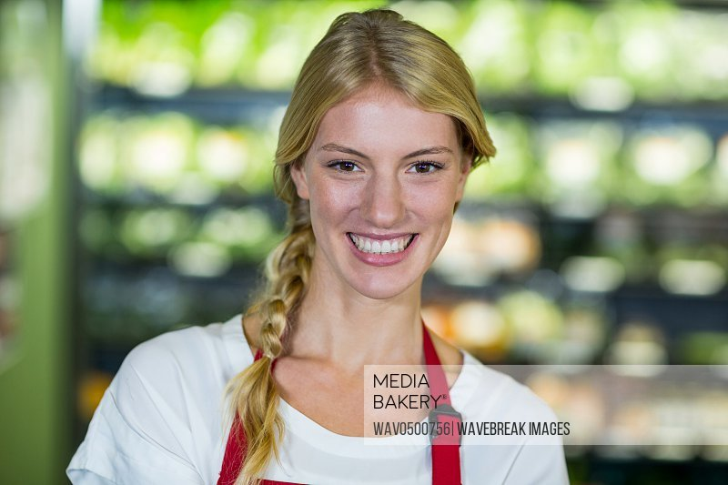 Portrait of smiling staff in supermarket