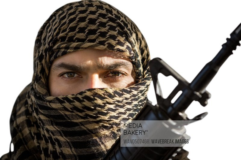 Portrait of soldier holding a rifle against white background