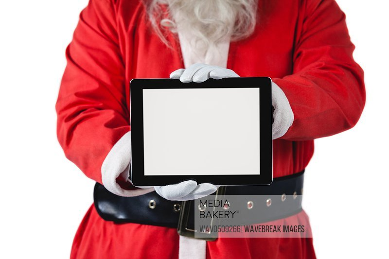 Santa claus holding digital tablet on white background