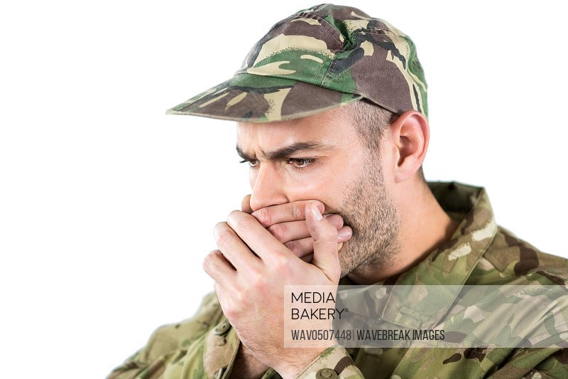 Soldier covering his mouth against white background