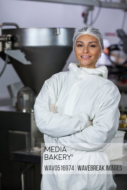 Female butcher standing with arms crossed