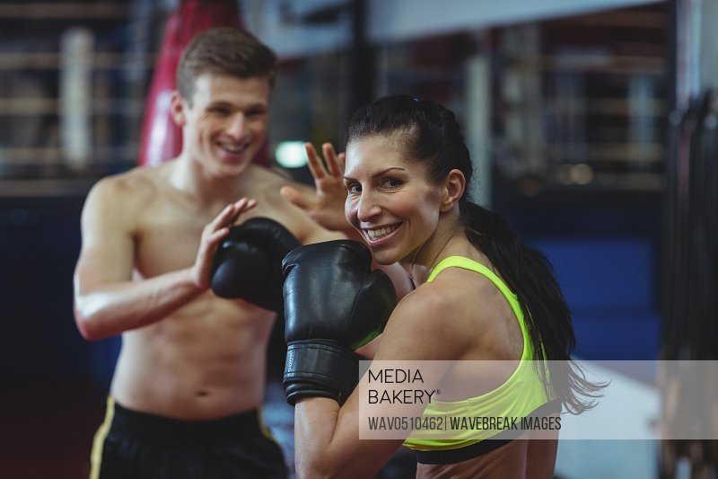 Boxers practicing a boxing in fitness studio