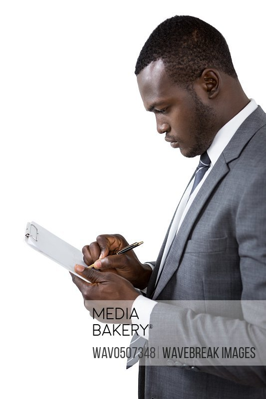 Businessman writing on clipboard against white background