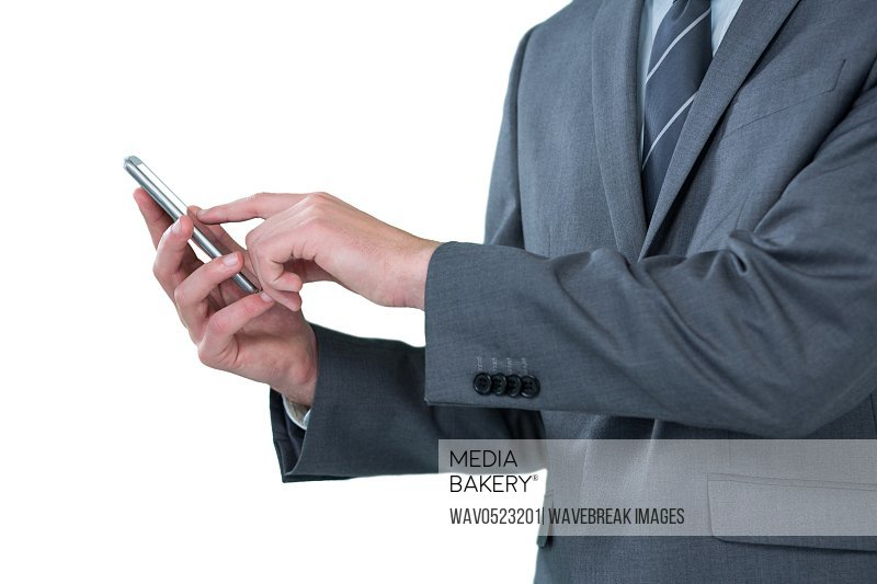 Mid section of businessman using mobile phone