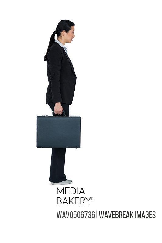 Businesswoman holding a briefcase against white background