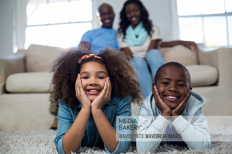 Portrait of children with their parents at home