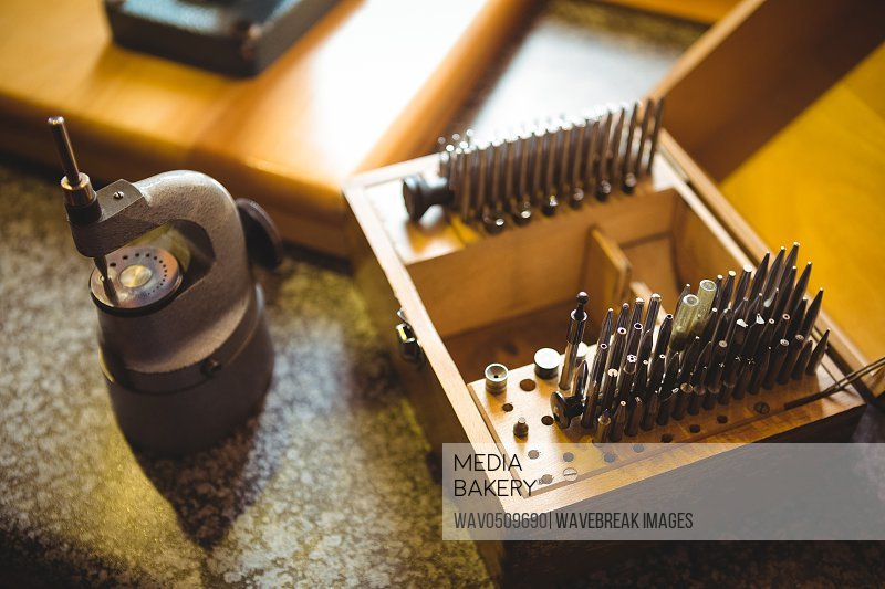 Close-up of drill bit set in a holder at workshop