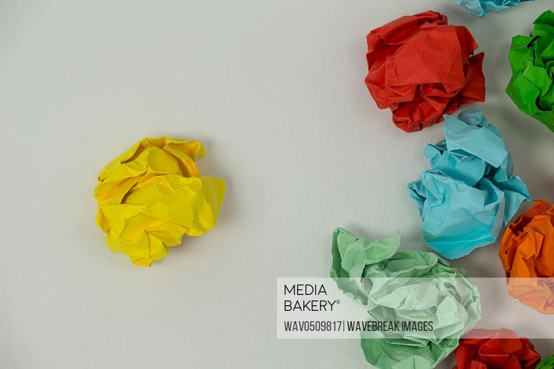 Close-up of colorful crumpled paper on a white background