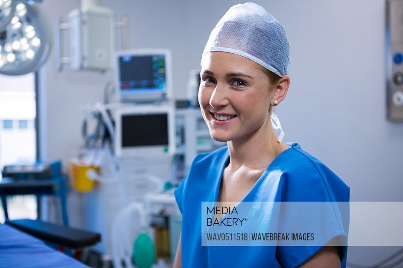 Portrait of female nurse smiling in operation theater at hospital