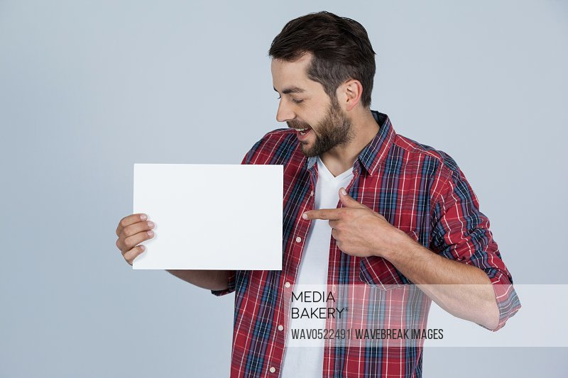 Happy man holding a blank placard