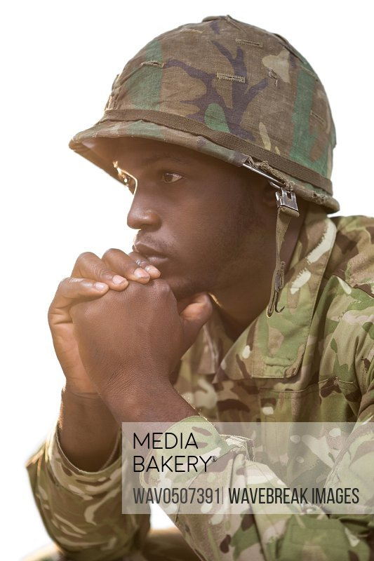 Close-up of thoughtful soldier against white background