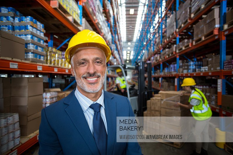 Portrait of warehouse manager smiling in warehouse