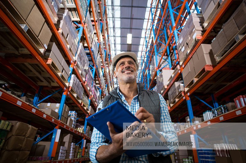 Warehouse worker checking the inventory in the warehouse