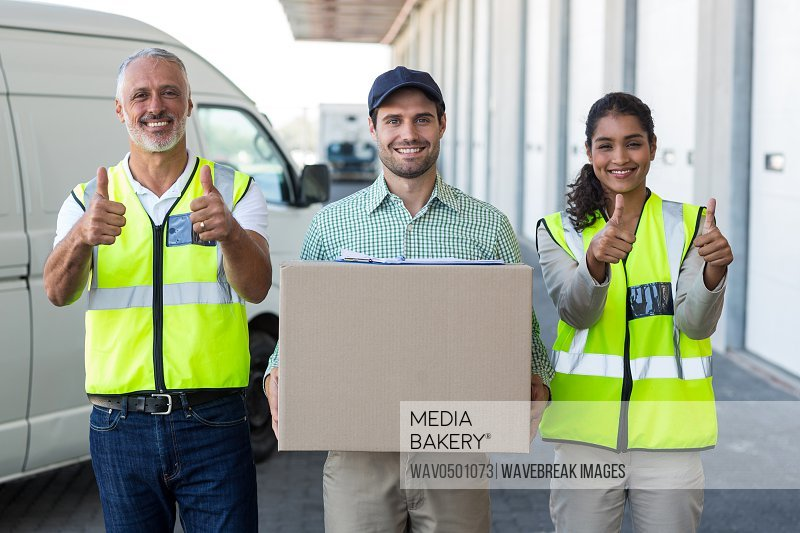 Portrait of warehouse worker and standing together outside the warehouse