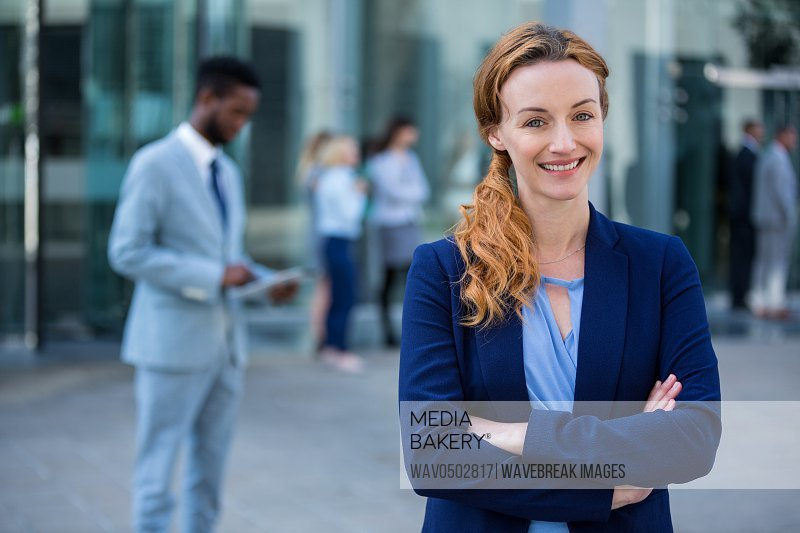Portrait of businesswoman standing with arms crossed in office building