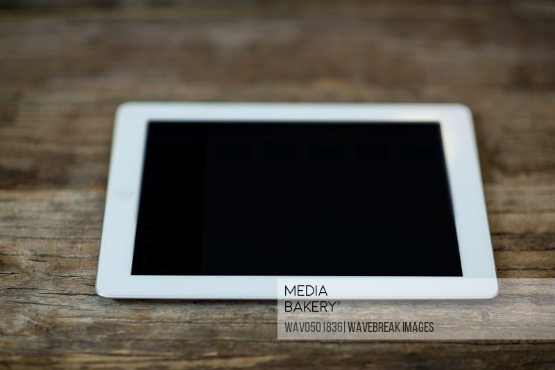 Digital tablet on a table at home