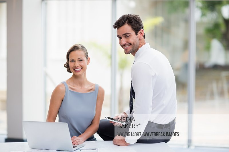 Business executives with laptop at conference centre
