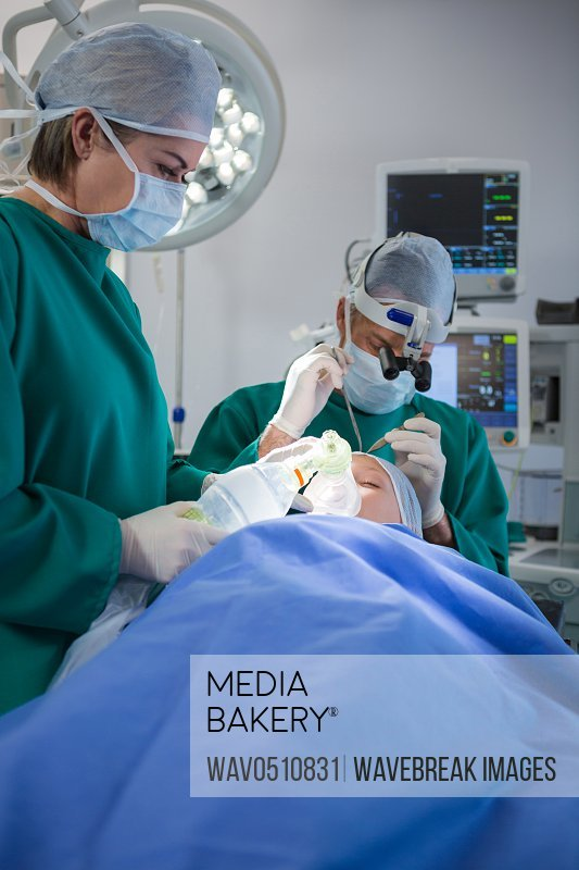 Surgeons operating patient in operation theater