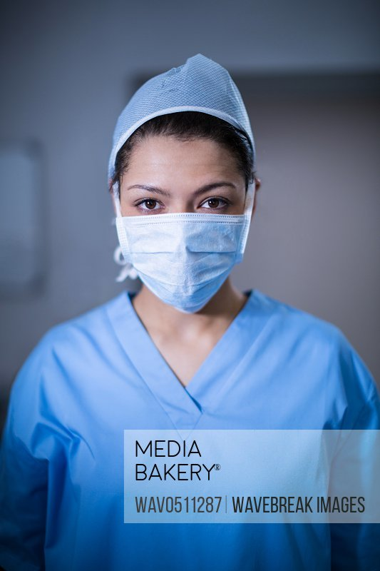 Portrait of female surgeon standing in operation room at the hospital