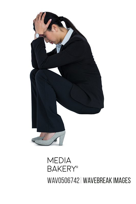 Depressed businesswoman sitting on steps with hand on head against white background