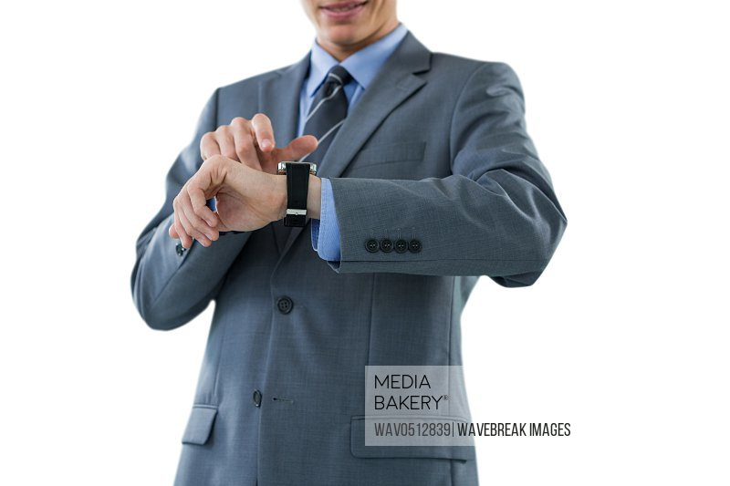 Mid section of businessman checking his smart watch