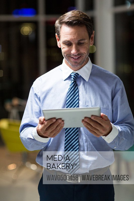 Businessman using digital tablet in the office